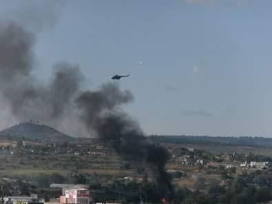 Policía Federal lanza gases en Huitzo desde helicópteros; CNTE prende fuego a alcaldía