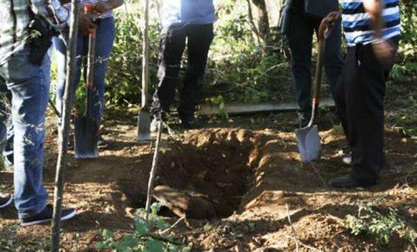 Localizan 14 cuerpos en fosa clandestina