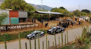 Elementos policíacos recuperan predio en el Río Atoyac