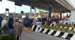 Pese a acuerdos, habitantes de Teopoxco toman caseta de Huitzo