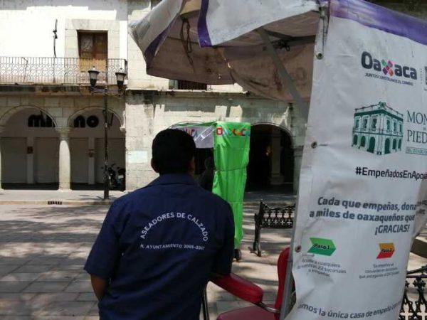 Crisis económica golpea fuerte a boleros en zócalo de Oaxaca