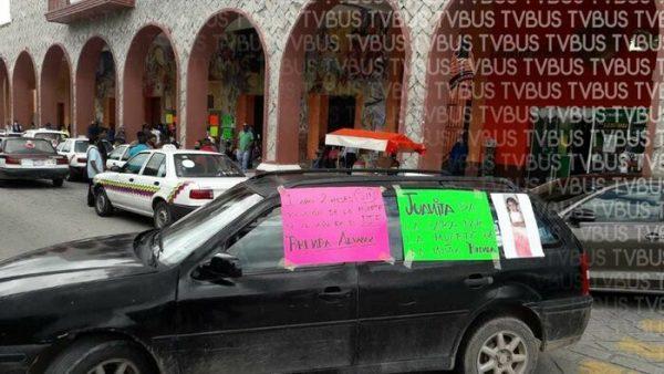 CATEM joven toma palacio municipal de Huajuapan de León, piden pago de brigadistas CONAFOR
