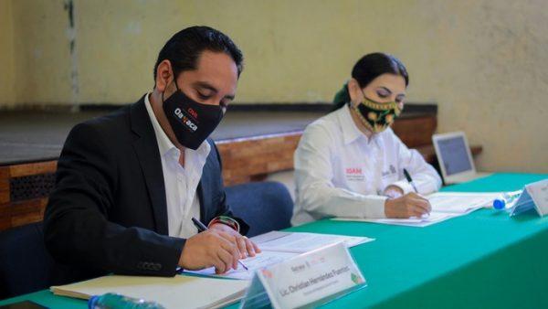 Firman IOAM y Registro Civil en Oaxaca, convenio para otorgar actas de extranjería a familias migrantes